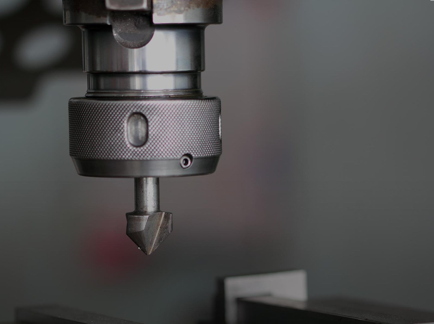 Page background image - Industrial drill press