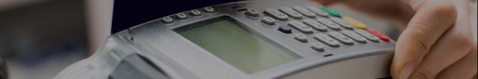 Header image - closeup of point of sale device in use