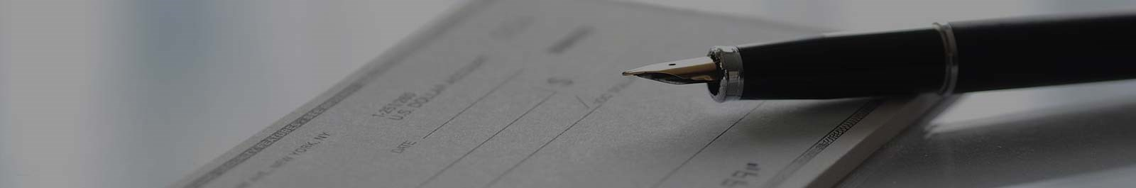 Header image - closeup of a pen and checkbook