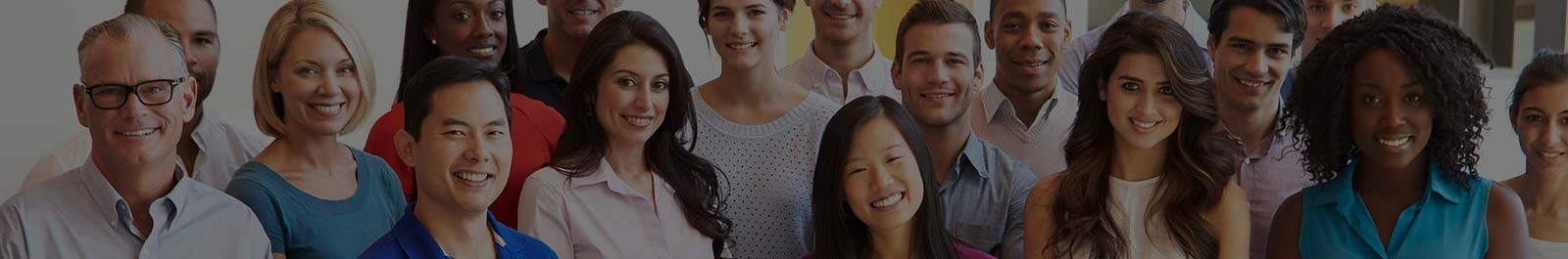Header image - office with diverse group of smiling employees