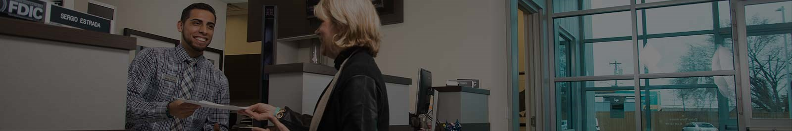 Header image - man and woman in an office setting