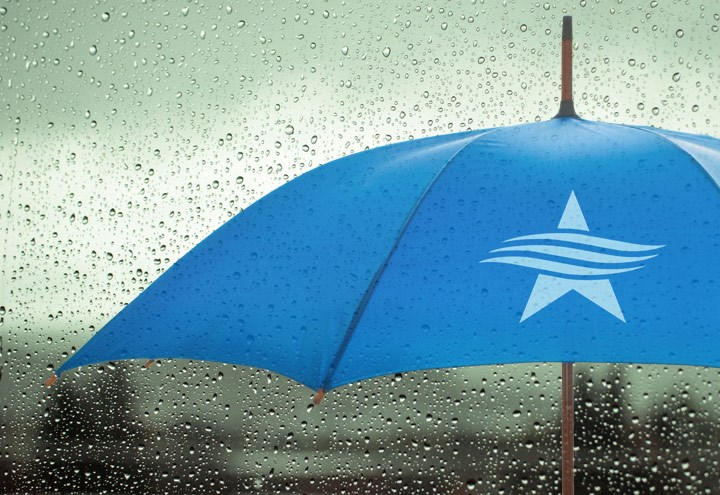 Image of rain on an umbrella with the TSB logo