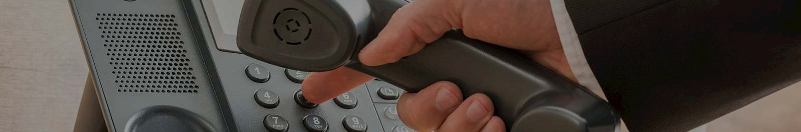 Header image - closeup of hand dialing a phone for help