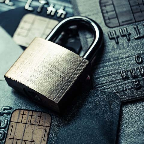 Image of lock with debit cards