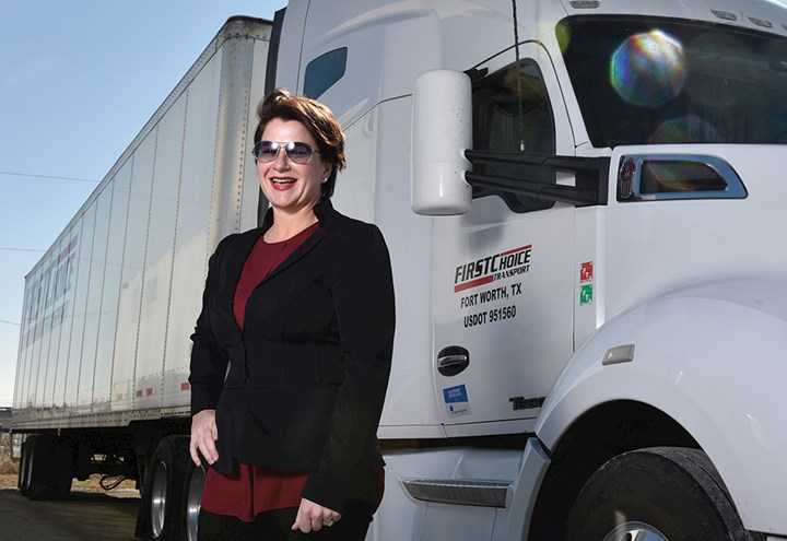 Photo of Carla Luig and semi truck